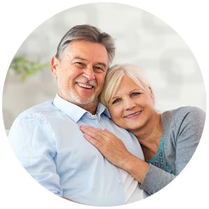 Retired couple siting down with wifes arm rested on husbands chest