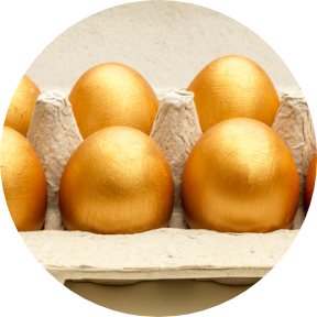 An image of 6 golden eggs in one tray.